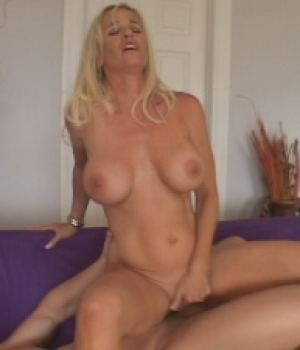 Blonde busty MILF riding a big cock