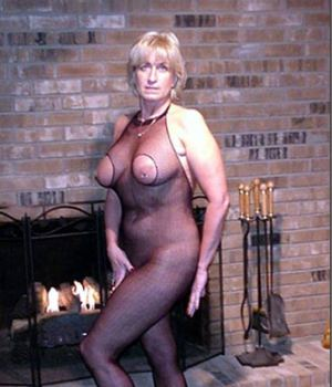 Blonde Granny Wearing A Mesh Overall Stockings With A Hole In Her Tits