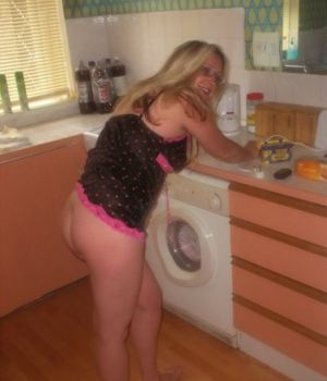 Drunk Blonde MILF Showing Her Ass In The Laundry