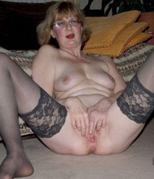 Horny Granny Spreading Her Pussy