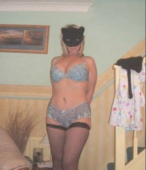 MILF in a cat mask and lingerie