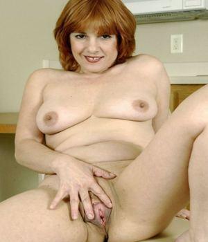 Redhead MILF Spreading Her Pussy