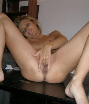 See This Blonde MILF Masturbating On A Table