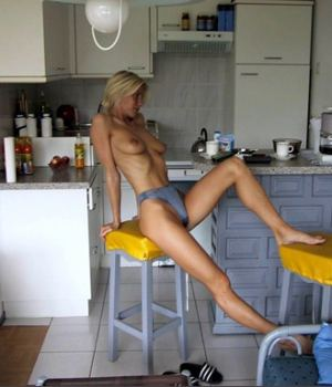 Skinny Blonde Only In Her Undies While In The Kitchen