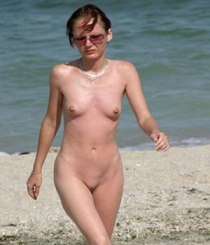 Slim MILF Nude On The Beach